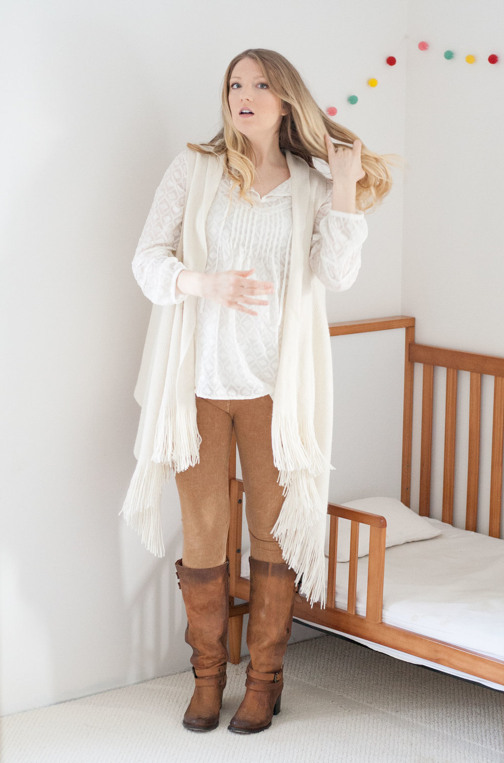 Pea in the Pod Maternity Blouse paired with my old,non-maternity white fringe sweater vest and tan suede-look leggings. Freebird Clive Boots .