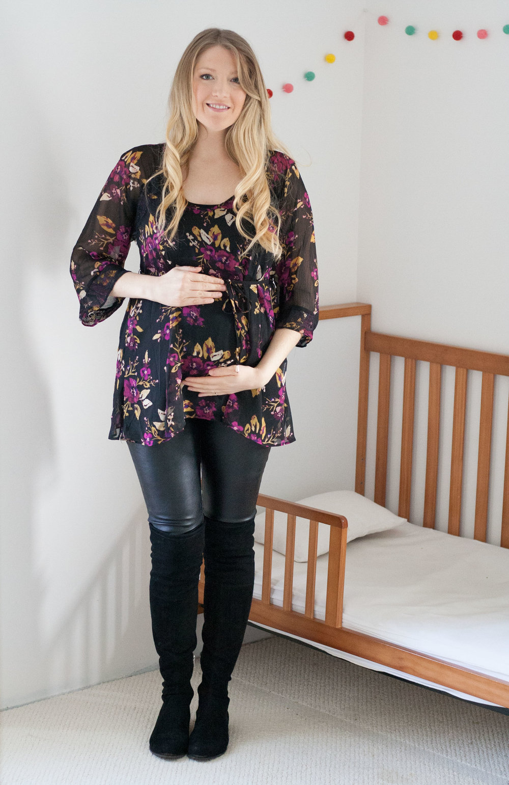 Jessica Simpson Maternity Hanky Hem Blouse paired with Destination Maternity Leather Look Leggings (similar here )and Marc Fisher Humor Over-The-Knee Boots .